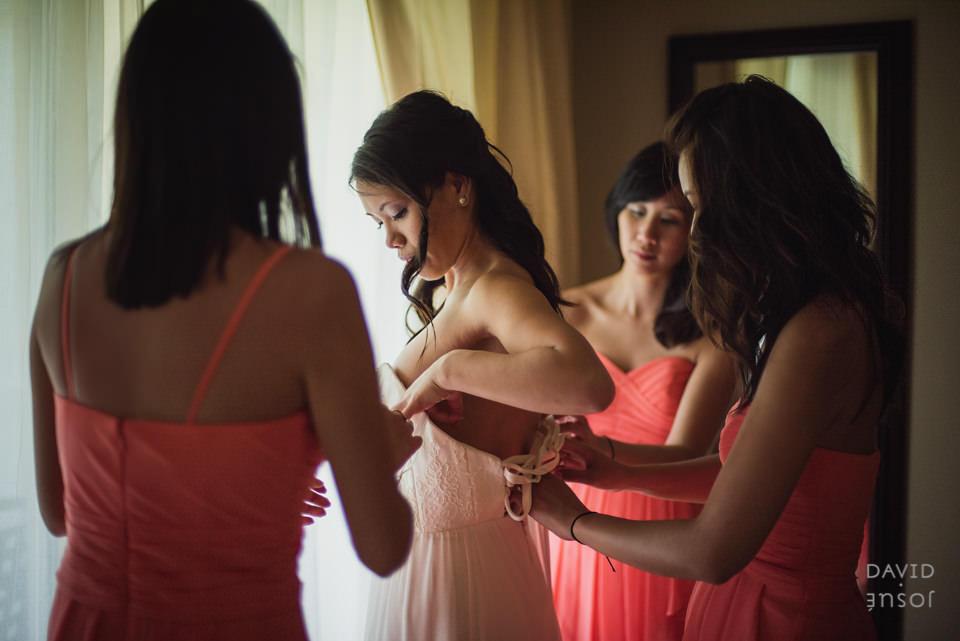 bride-getting-on-wedding-dress